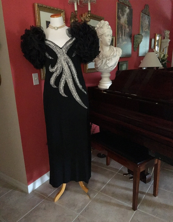 Regal black knit and beaded evening gown. Multi ru