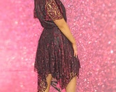 One Off Burgundy Red Wine Lace Dress with Jaggered Hemline. High Neckline Short Lace Sleeves Midi Length Lined in Black. A-Line Cut