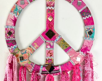 Pink sari silk, peace sign wall hanging. Perfect for boho home decor. Unique gift.