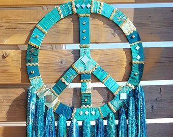 Peace sign wall hanging in peacock blue and green sari silk upcycled pieces and lots of sparkle