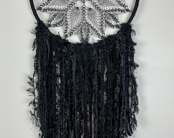 Black doily dream catcher like wall hanging. Perfect as bedroom decor, goth wedding, meditation space and more.