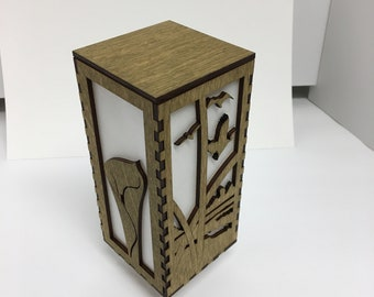 A beautiful decorative lamp with a hand cut dovetailed case and kumiko face.