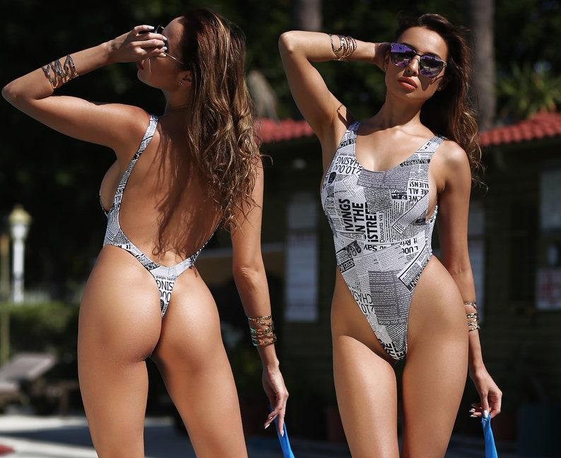 30eee736fac White Newspaper One Piece Swimsuit Bodysuit Bathing Suit image 0 ...