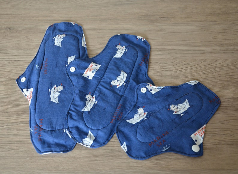 Test package: 5 washable sanitary towels (SHL) and slip protector