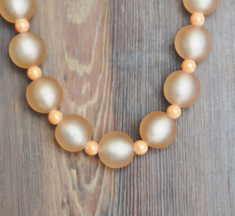 bead choker Beautiful translucent peach Strung on wire with small marbled salmon spacer beads necklace 1950s Lovely. large glass ball