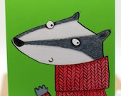 Happy Christmas. Badger. Christmas jumper. Christmas pud. Happy Xmas. Illustrated card.