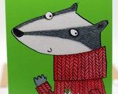 Happy Christmas. Badger. Christmas jumper. Christmas pud. Happy Xmas. Illustrated card.