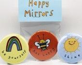 Happy Mirrors. Pocket mirror. Be yourself. Bee Happy. Shine. LGBTQ+. Teens. Mental health. Pride. Rainbows. Positivity.