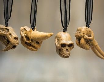Prehistoric Animal Skull Ornaments- Smilodon, Arsinoitherium, Australopithecus, Mastodon