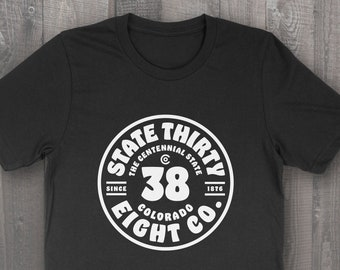 State 38 Co Colorado Badge T-Shirt