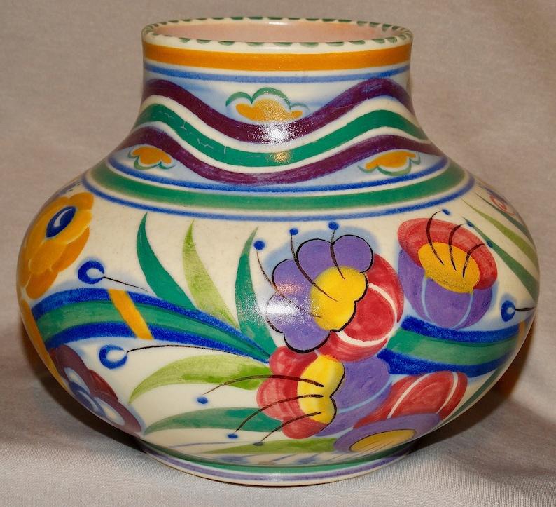 1930s hand-thrown shape \u2018424/' vase hand-painted by Eileen Prangnell in the \u2018YO\u2019 pattern POOLE designed by Truda Carter.