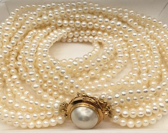 Vintage 14k gold mabe pearl clasp 7 strand freshwater 3mm. pearl Necklace
