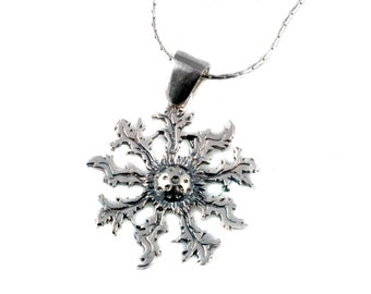 EGUZKILORE, pendant designed in sterling silver. Silver chain or cotton gift. Handmade. Presented in jewelry box. Edelweiss.