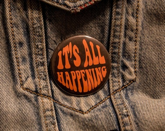 It's All Happening button 2.25 inch
