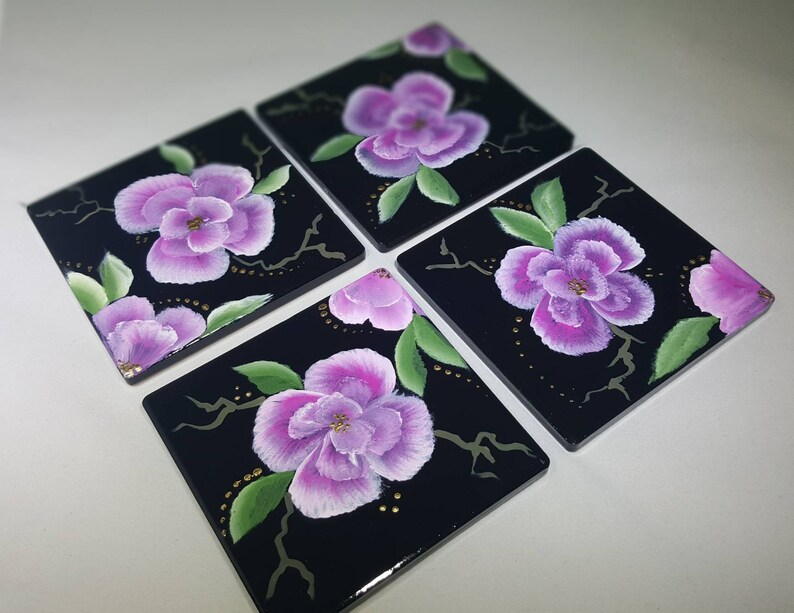 Hand painted pink and white flowers on a blaxk 4x4 ceramic tile coaster
