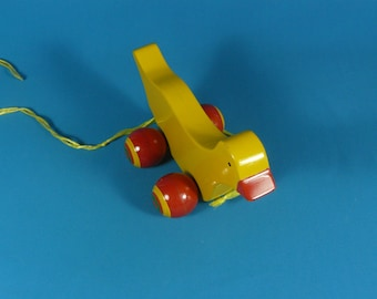 Vintage wood duck toy for pulling red-yellow 80s