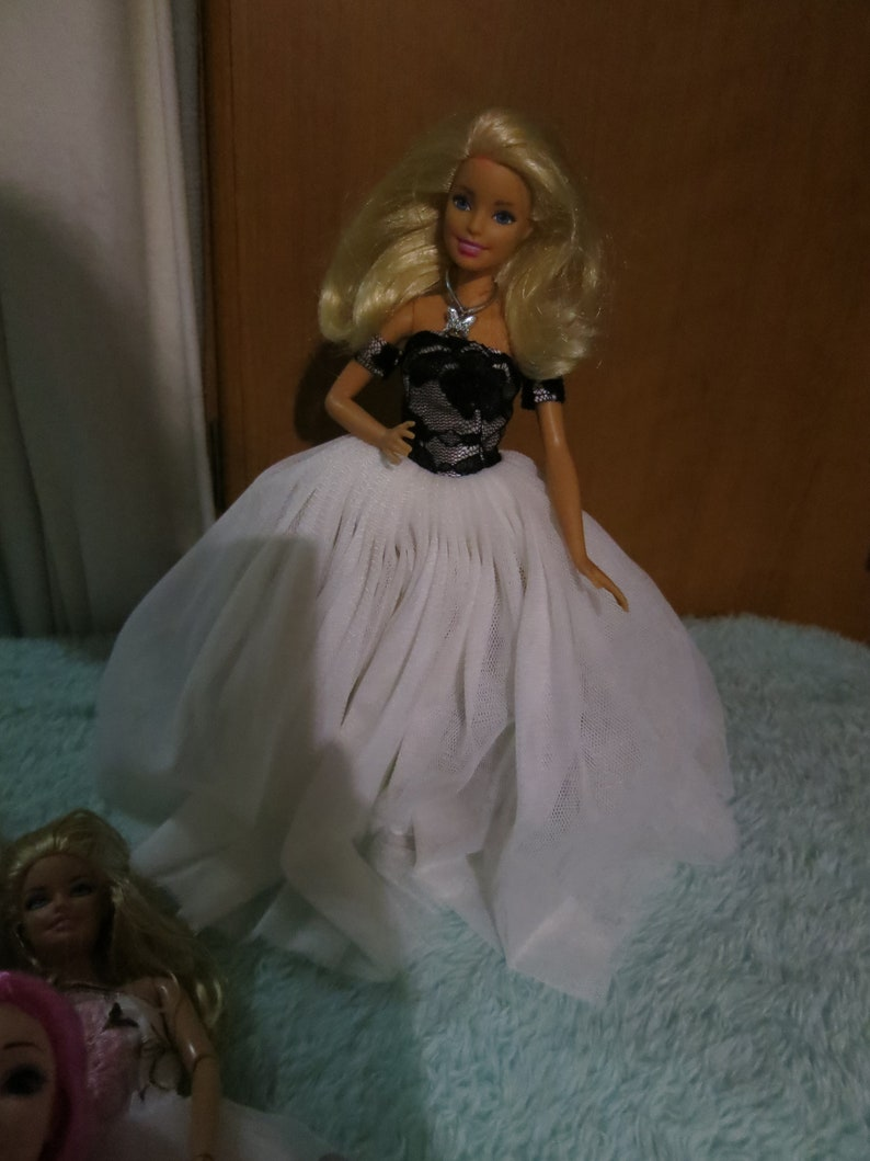 9ddb2cd1142 Barbie dressed in white chifon with black lace top lovely doll