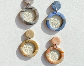 Clay marble earrings with leather center