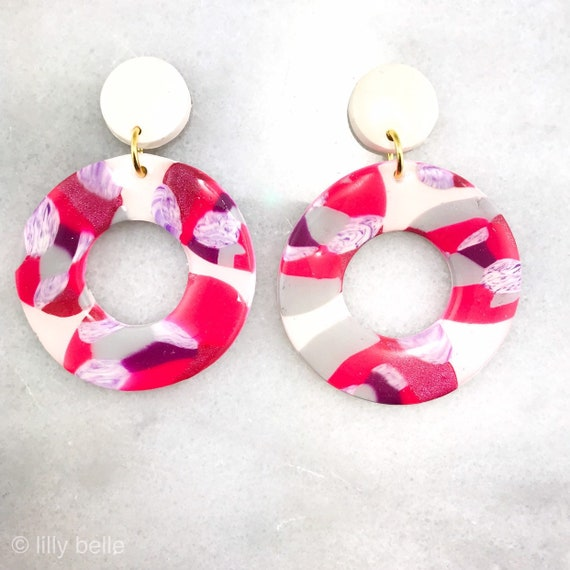 Lightweight fun and one of a kind. Polymer clay stud earrings Statement stud earrings