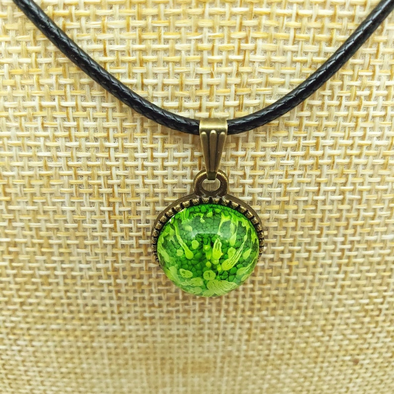 Beautiful and unique one of a kind Original Art Piece. Little Green Circle Abstract Pendant in Antiqued Bronze Tree of Life setting