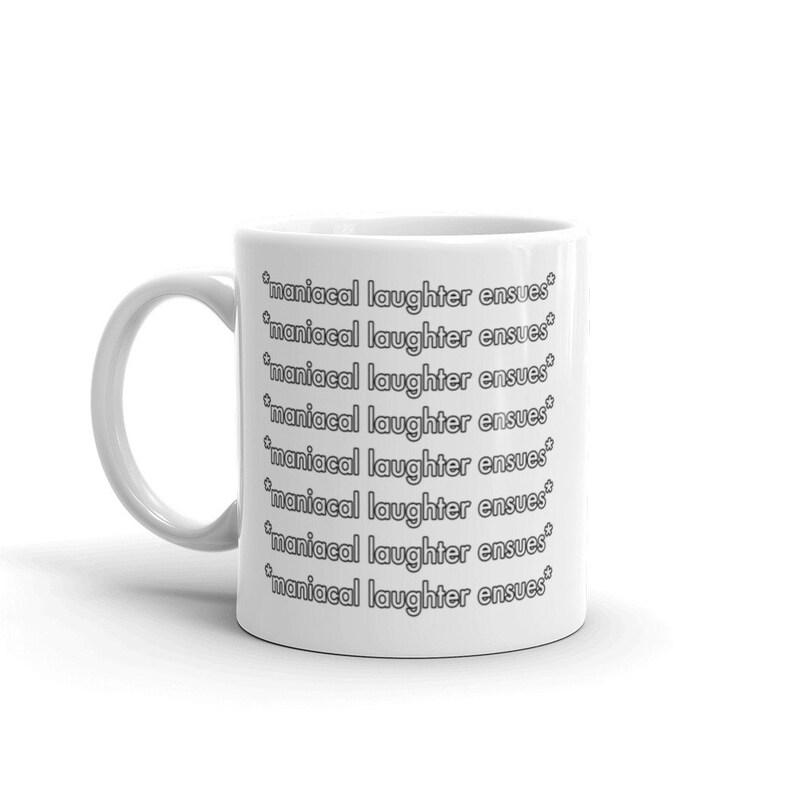 maniacal laughter ensues White Ceramic Coffee Mug image 0