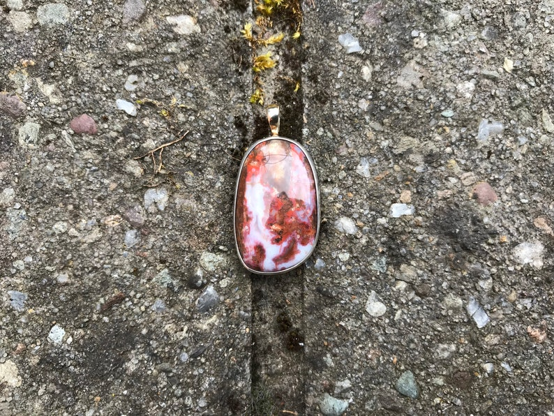 Stunning Scottish Burn Anne agate pendant set in sterling silver with gold bail.