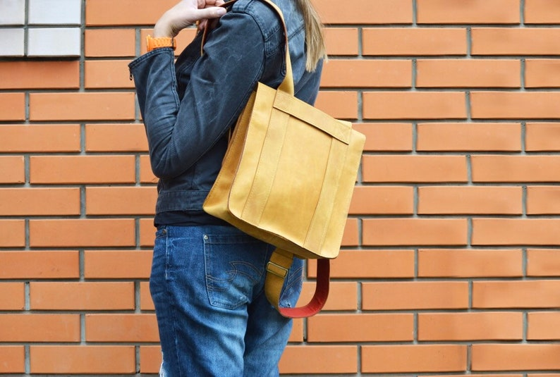 Nice backpack leather woman lady unisex curry orange color safe against theft bag quadratic originally extravagant long carrier student