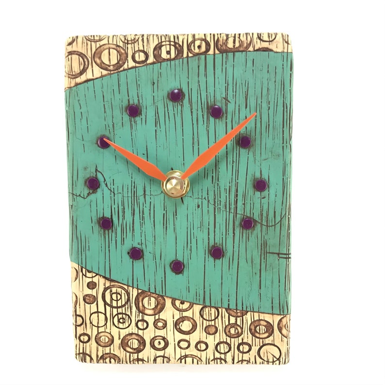 Turquoise Clock with Textured Circles image 0