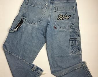 5c1ada2ac4bb77 1990s Vintage Fubu Apparel Company Jeans - 90s Fubu Jeans Big Logo Spell  Out Denim Pants - 90's Hip Hop Clothing Hypebeast Streetwear