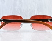 Cartier rimless Buffs Chocolate Buffalo Horn C decor Platinum sunglasses Strawberry lens Artifact