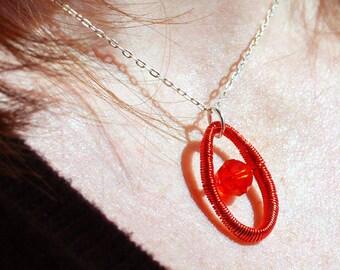 Hand coiled wire pendant with Swarovski crystal - tangerine orange colour