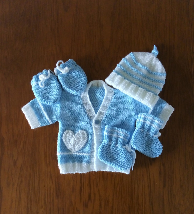 Short sleeved cardigan with hat To fit 0 to 3 months. bootees and mittens  Hat has a cute knot top hand knitted 4 piece set for baby boy