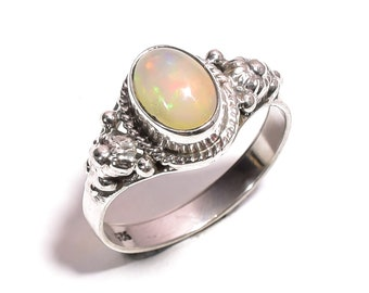 5bd2ca8ab4e0e Turquoise opal ring | Etsy