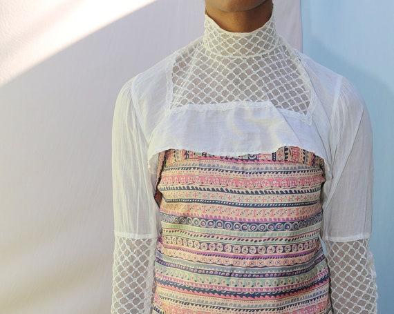 Graphic antique Victorian sheer off white lattice rose net ultra cropped transparent turtleneck mock neck collar bodice top blouse shirt