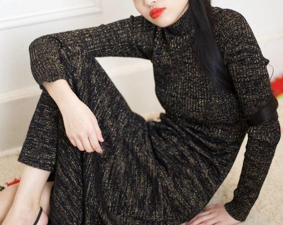 Chic 70's designer black ribbed knit gold lurex detail mock neck turtleneck fitted flattering maxi length long sleeve knit dress frock gown
