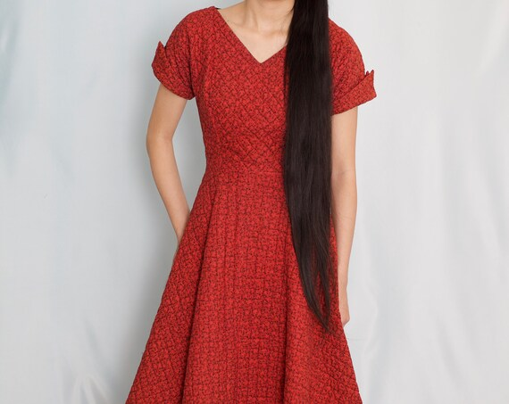 Textural 50's quilted crimson red subtle black print cap sleeve zip side fitted waist v neck wide structured skirt midi dress frock gown
