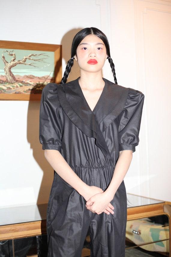 Shapely 80's shiny black sheen cotton blend ruffle shawl collar puff sleeve straight leg basic minimal chic jumpsuit romper coveralls