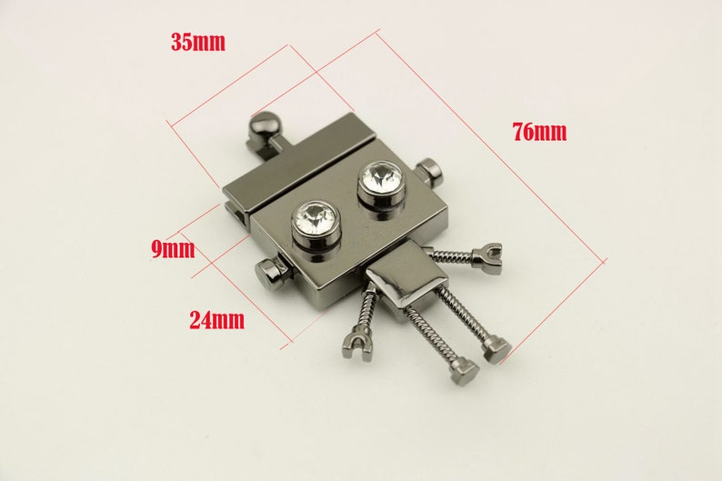 purse supplier hardware accessories  NFL-168 silver and brass color gunmetal 10pcs76*35mm robot bags purse  thumb mechanism lock in gold