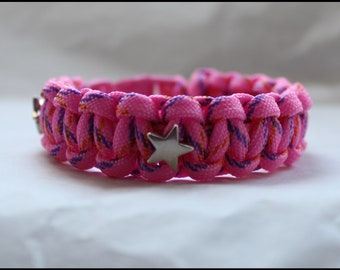 Survival bracelet in pink rope and silver stars