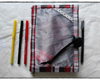 Handcraft creative book with tartan and linen fabrics, felt-tip pens ans skull