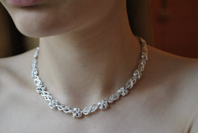 Silver necklace with flowers