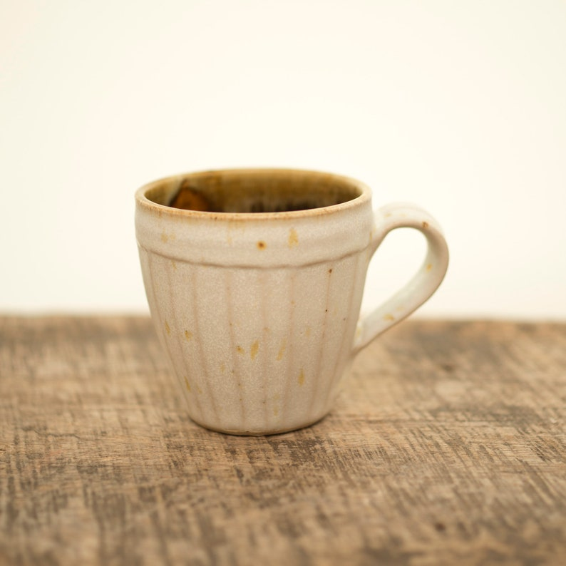Pottery mug with hand carved decoration and white speckle image 0
