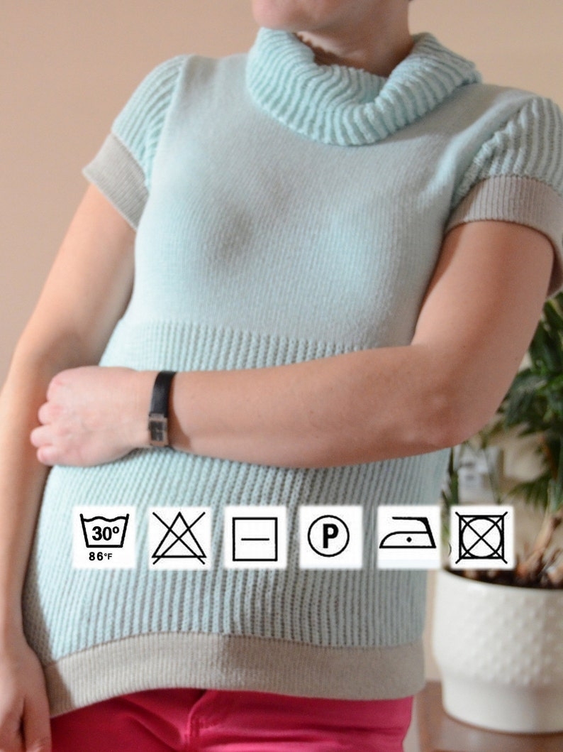 Summer Knitted cotton Blouse with short sleeves and turtleneck in aero blue color and lightgray inserts with amusing pattern  for women