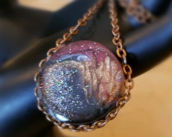 Enchanting Deep Blue and Copper Swirl Pendant set in Antique Copper Chain