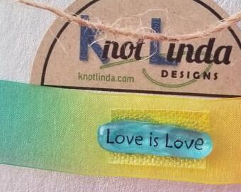 "Satin Rainbow Ribbon Choker with ""Love is Love"" Charm"