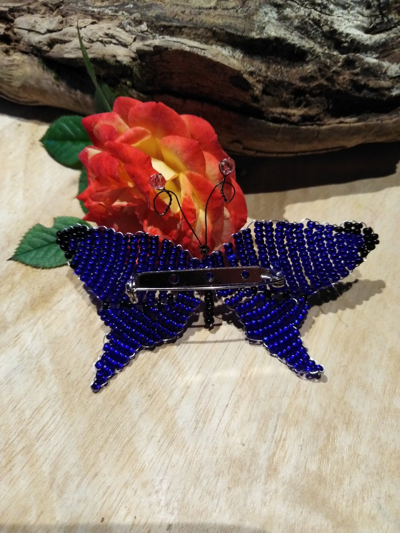 Butterfly brooch made of blue glass beads