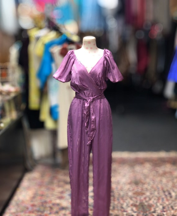 70s purple jumpsuit with gold stripes matching tie