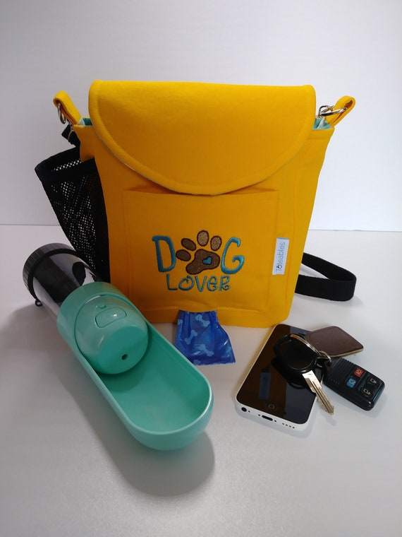 Schnauzer dogwalking bag with built in poopy-bag dispenser and custom-embroidered front pocket with pet/'s name
