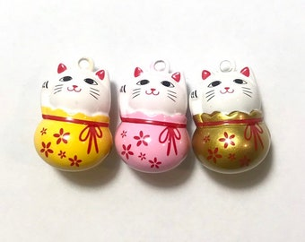 Japanese Lucky cat charm with jingle bells inside.