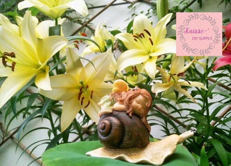 Miniature fairy garden supply Garden Miniature Cute baby sleeping on the snail